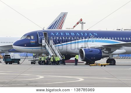 MOSCOW, RUSSIA - SEPTEMBER 26, 2014:  Airbus A320 Azerbaijan Airlines on the apron of Domodedovo Airport expects passenger compartment cleaning team.