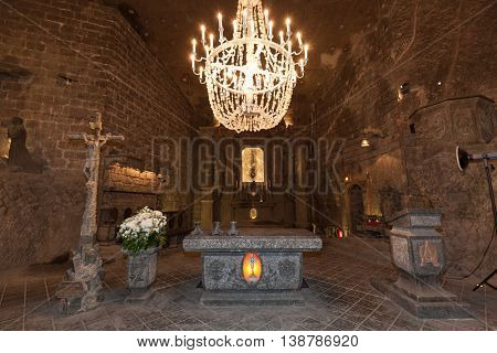 Wieliczka, POLAND - July 01:, 2016: Alter in St. Kinga's Chapel inside Wieliczka salt mine. UNESCO World Heritage Site