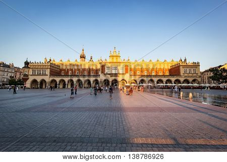 CRACOW, POLAND - June 29, 2016: The Cloth Hall, Polish Sukiennice in sunshine. Old medieval town of Cracow is listed as UNESCO heritage site.