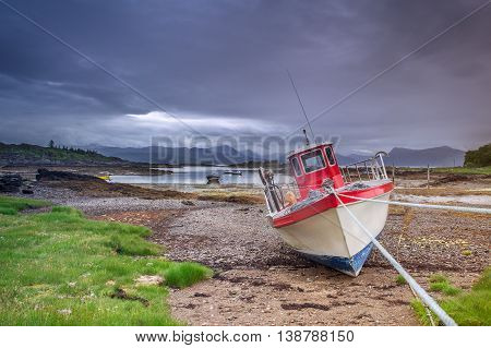 Fishing Boat at Low Tide on Scottish Coast of Isle of Skye
