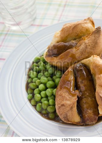 Individual Toad in the Holes with Gravy and Peas