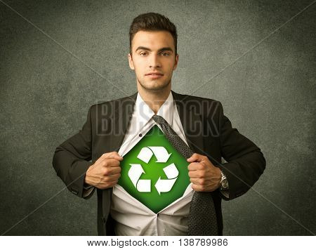 Enviromentalist business man tearing off shirt with recycle sign on his chest concept on backround