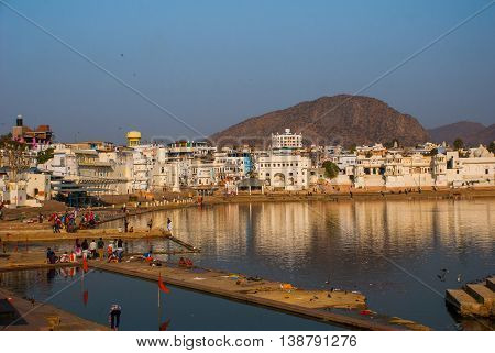 View Of The City Of Pushkar, Rajasthan, India. Houses Reflected In The Water. A Beautiful Lake.