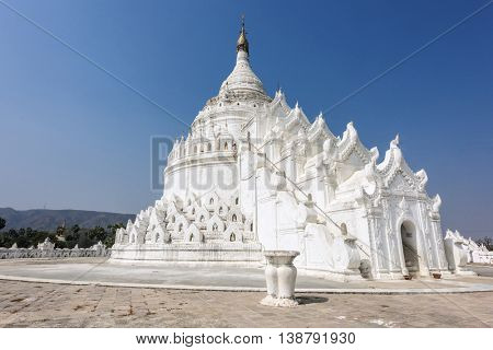 Shrine on the top of beautiful white Hsinbyume Pagoda in Mingun, Western bank of Irrawaddy river, Myanmar