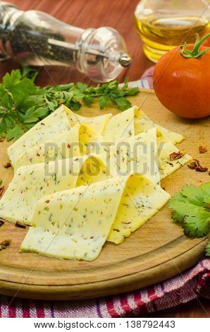 pieces of sharp cheese with spices on the kitchen Board
