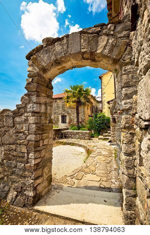 Town of Hum stone gate and street vertical view Istria Croatia