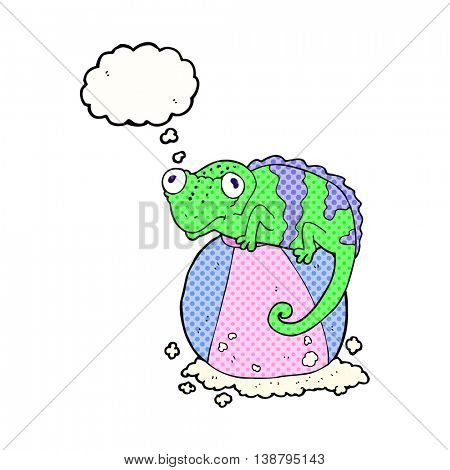 freehand drawn thought bubble cartoon chameleon on ball