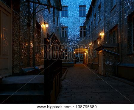 House, mirrors and light.  Lodz, Poland - February 28, 2016 Lined with pieces of mirrors house on Piotrkowska Street in Lodz in the evening scenery.