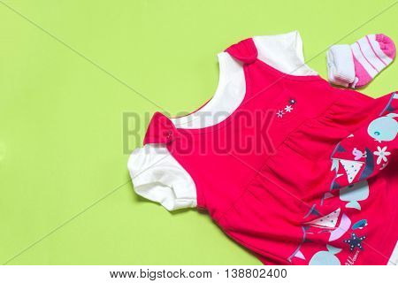 Clothes For Baby Girl On Light Background. Copy Space For Text