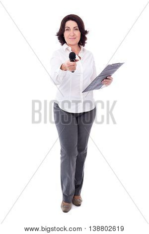 Mature Female Reporter With Microphone And Clipboard Isolated On White