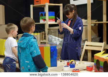 ST. PETERSBURG, RUSSIA - JUNE 28, 2016: Kids participating in the master class in making robo-heads during the interactive exhibition Ball Of Robots. Last year the exhibition was visited by 200,000