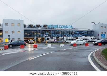 BUCHAREST, ROMANIA - MARCH 11, 2016: Passenger terminal of Henri Coanda International Airport. The airport was opened in 1969 on the place of military air base at Otopeni