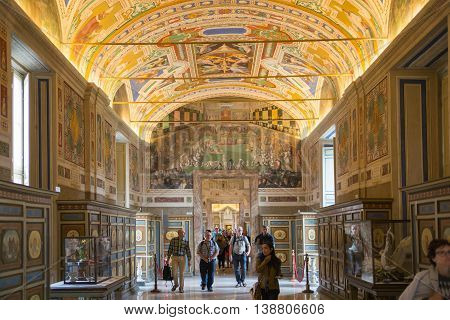 ROME, ITALY - APRIL 8, 2016: Museums of Vatican painted galleries. Exhibition hall with walking people