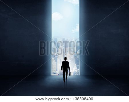 businessman standing in front of the huge gate