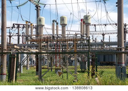 high voltage wires and insulators power station against the blue sky