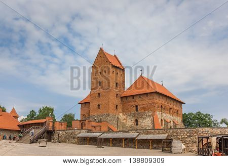 TRAKAI, LITHUANIA - JUNE 22, 2013: Courtyard of the Trakai red brick castle in Lithuania