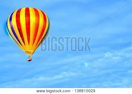 Colorful yellow multicolored striped Balloon in flight