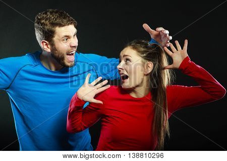 Husband abusing wife. Aggresive man screaming at scared afraid woman. Domestic violence aggression. Bad relationship.