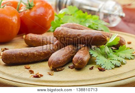 meat spicy sausage on the table closeup
