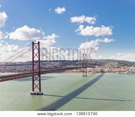 Panorama of Lisbon cityscape with 25 de Abril suspension Bridge, Portugal