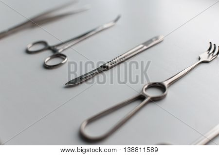 Surgical set on a white table. Metal tools