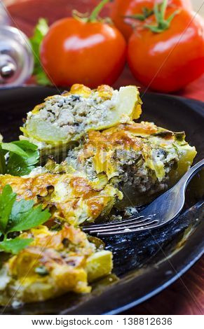zucchini stuffed with meat on a plate closeup