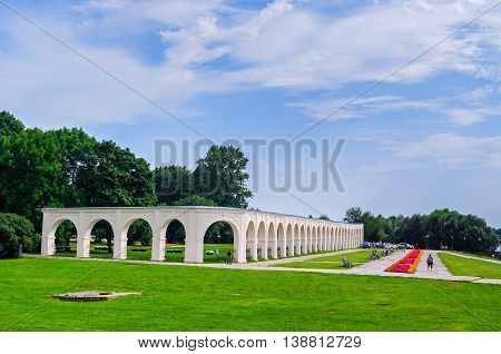 VELIKY NOVGOROD RUSSIA - JULY 15 2016. Park and Yaroslav's courtyard arcade in summer sunny day in Veliky Novgorod Russia - summer cityscape in Veliky Novgorod