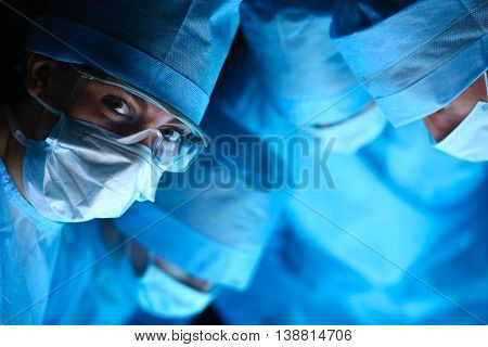 Young surgery team in the operating room .