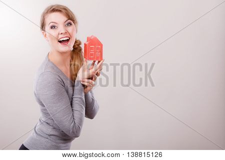 Smiling Woman Holding House Model.
