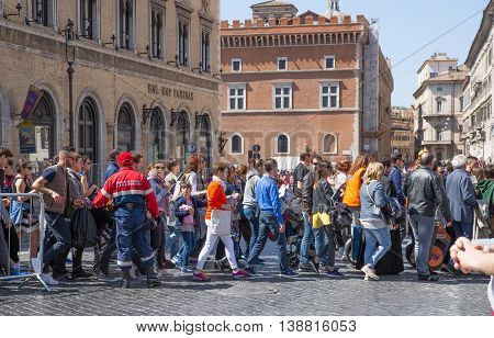 ROME, ITALY - APRIL 8, 2016: Crowd of people crossing the road during the Rome's marathon