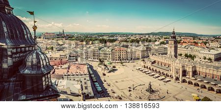 Cracow, Poland panorama. View on the the old town market square and Cloth Hall from the top of the St. Mary's Basilica Tower. Vintage