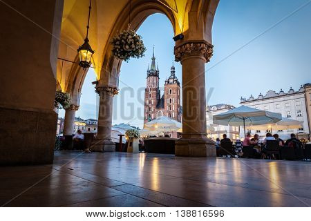 View from the Cloth Hall to the Cracow main market square and St. Mary's Basilica also known as Mariacki Church.