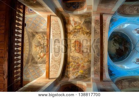 VELIKY NOVGOROD RUSSIA-JULY 15 2016.Architecture indoor view- decorated arched ceiling with paintings of Bible scenes and choirs in the interior of St Nicholas Cathedral. Soft filter applied