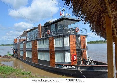 NAUTA, PERU - OCTOBER 17, 2015: The Aqua Amazon River Cruise Ship. The luxury ship is shown at it home port in Nauta ready to take on passengers.