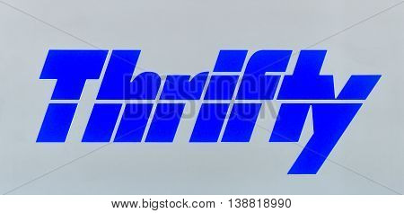 Thrifty Dollar Car Rental Sign And Logo