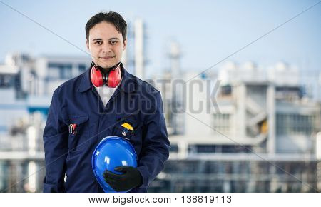 Portrait of a worker in front of a factory
