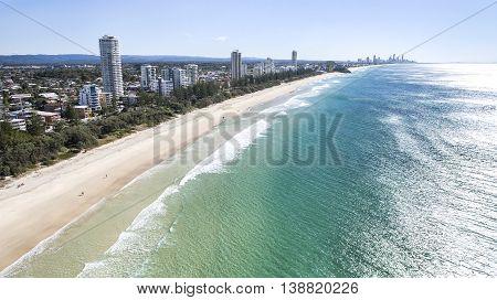 Aerial view of Burleigh beach as the sun rises over the ocean. Gold Coast, Australia