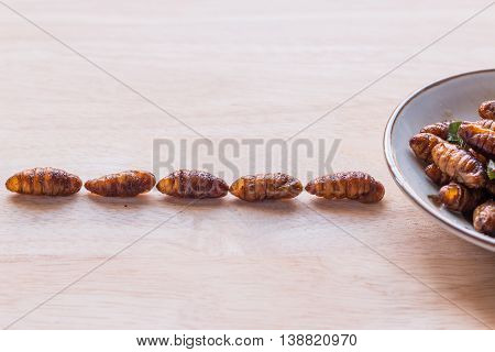 Fried Insects - Wood Worm Insect Crispy Walking Into The Dish On Woodern Background, Abstract, Conce