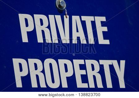 Close Look at Blue and White Private Property Sign