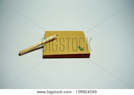 Many Recycle paper and wooden pencil on white background