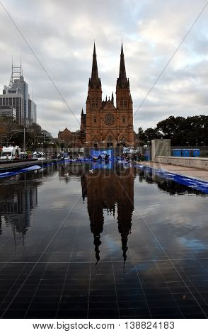 Sydney Australia - July 17 2016. Water reflection of St. Mary's Cathedral. Last day of the Winter Festival at St. Mary's Cathedral. The Winter Festival in Sydney is Australia's largest winter events featuring open-air ice-skating.