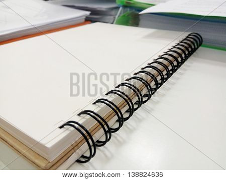 Note book open on desk in the office