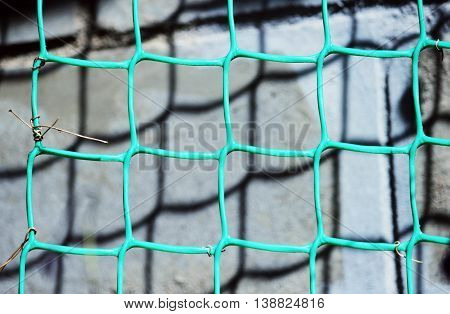 background from green plastic netting for climbing plants