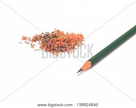 green pencil with pencil sawdust in its left side