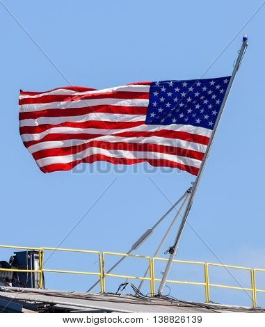 American Flag flying over the USS Theodore Roosevelt in San Diego Bay on Independence Day