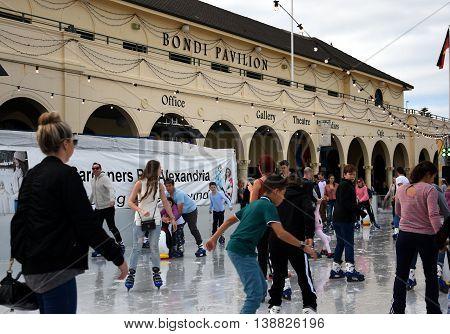 Sydney Australia - Jul 17 2016. Kids and parents are ice skating on Bondi ice rink. Australia's only beachside ice rink is on Bondi beach.