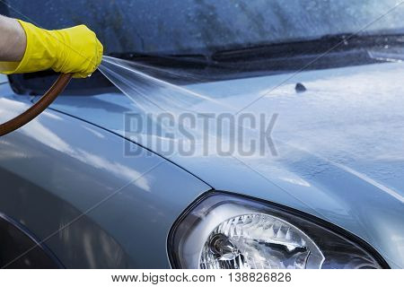 blue car is washing in soap suds