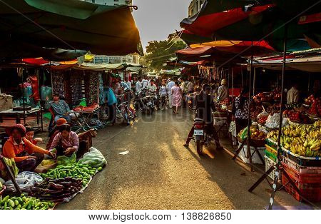 The sun goes down over a market selling fresh fruit in Cambodia