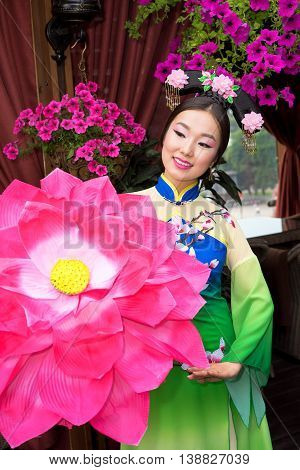 Chinese girl with traditional dress and lotus flower parasol