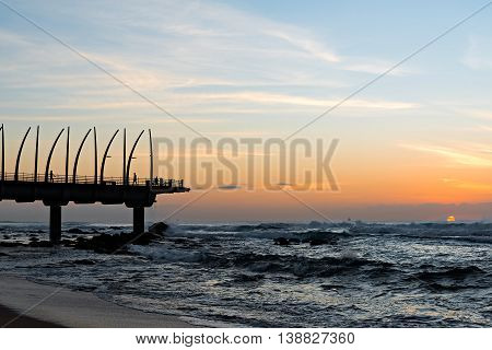 View of the Indian Ocean through the Millennium Pier in Umhlanga Rocks at Sunrise